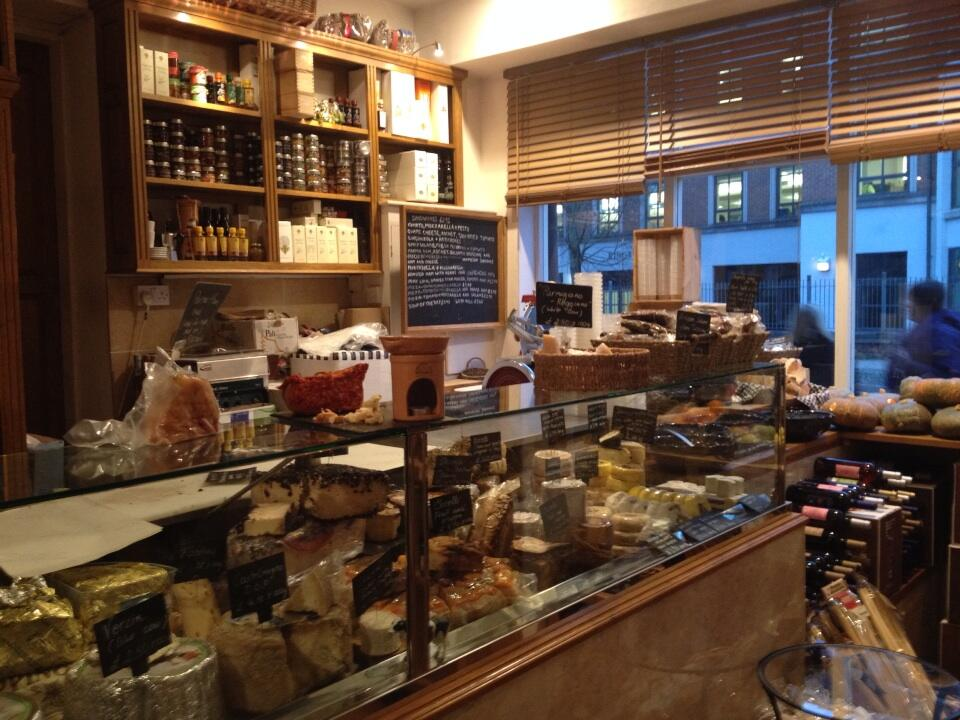Le Langhe's deli counter packed with Italian meats and cheeses
