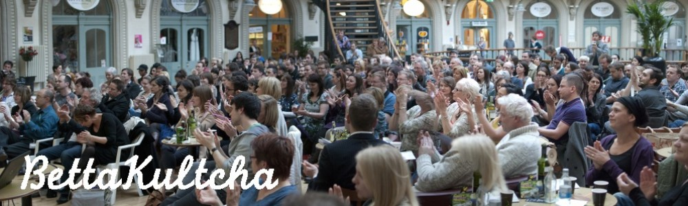 A crowd claps as they watch the presentations at Bettakultcha York