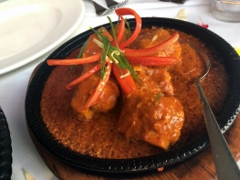 AFRAAN CHICKEN - Charcoal baked pieces of chicken cooked in royal spices, fresh green chilli paste & garnished with fresh garlic cloves (Hot taste).